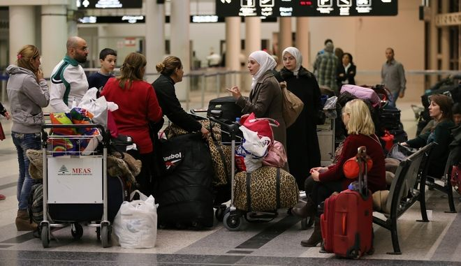 FILE - In this Friday, Nov. 20, 2015 file photo, travellers stand next to their luggage at the departure terminal of Rafik Hariri international airport, in Beirut, Lebanon. A Lebanese official said on Friday, Jan. 15, 2016 reports that Beirut International Airport doesnt meet international safety standards are exaggerated but acknowledged that the facility needs improvement. (AP Photo/Hussein Malla, File)