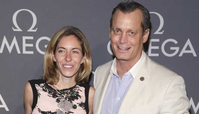 Nicole Mellon, left, and Matthew Mellon, right, attend the Omega Speedmaster Dark Side of the Moon launch event on Tuesday, June 10, 2014, in New York. (Photo by Andy Kropa/Invision/AP)