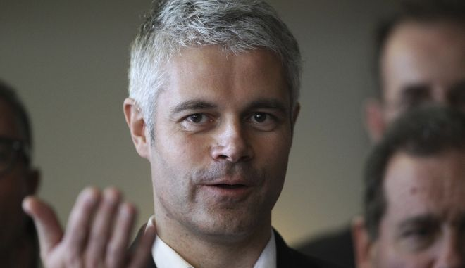 """Laurent Wauquiez, who campaigns to become the new head of the conservative """"Les Republicains"""" party, is pictured during a meeting in Bayonne, southwestern France, Saturday, Nov.25, 2017. (AP Photo/Bob Edme)"""