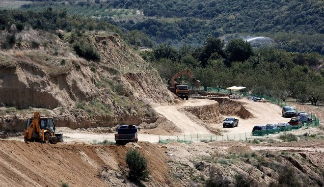 A general view of a site where archaeologists are excavating an ancient tomb at Kastas hill in Amphipolis, northern Greece on August 14, 2014. Archaeologists excavating an ancient mound in northern Greece have uncovered what appears to be the entrance to an important tomb from about the end of the reign of ancient warrior-king Alexander the Great.