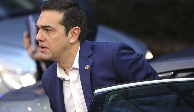 Greek Prime Minister Alexis Tsipras arrives for an EU summit at the EU Council building in Brussels on Friday, Dec. 15, 2017. European union leaders meet Friday to launch Brexit talks into a new phase and to discuss the euro and banking union. (AP Photo/Olivier Matthys)