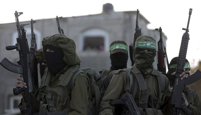 Hamas masked gunmen attend a rally against US decision to recognize Jerusalem as Israel's capital, in Beit Hanoun, northern Gaza Strip, Thursday, Dec. 7, 2017. A number of U.S. allies in the Middle East are condemning the Trump administrations decision with the United Arab Emirates, Kuwait, Qatar and Saudi Arabia urging Washington to reconsider and reverse the announcement. (AP Photo/ Khalil Hamra)