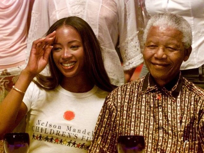 British model Naomi Campbell (L) and former South African president Nelson Mandela before his press conference in Barcelona June 30, 2001. Campbell and Nelson Mandela will attend a show called