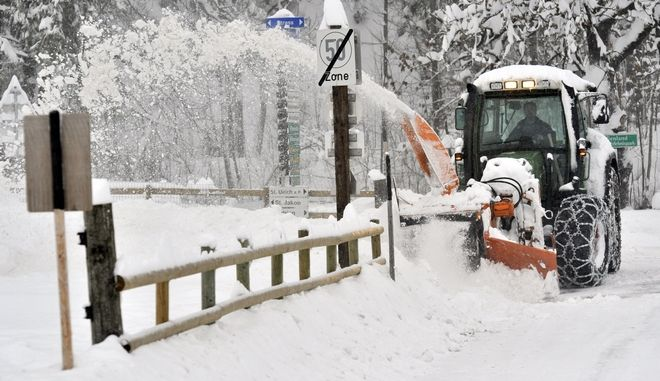 A snow blowers clears snow from a street near St. Ulrich in the Austrian province of Tyrol, Saturday, Dec.11, 2010. The weather forecast predicts heavy snowfall and cold temperatures for the next days. ( AP Photo/ Kerstin Joensson)