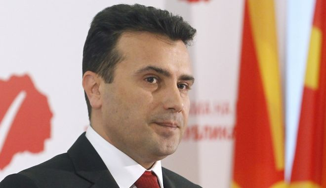 Zoran Zaev, leader of the opposition Social Democrats, presents the program of the new Macedonian Government, at the party headquarters in the capital Skopje, on Friday, March 10, 2017. Macedonia's left-wing opposition leader presented Friday the program for the new government he plans to form, although he is still waiting for mandate from the President Ivanov. (AP Photo/Boris Grdanoski)