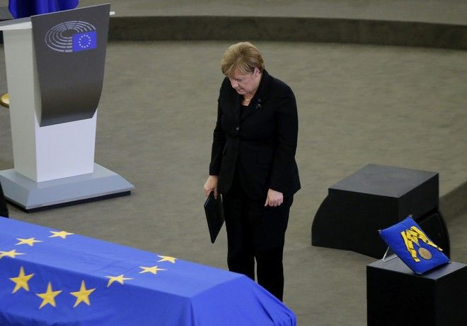 German Chancellor Angela Merkel pays her respects to former German Chancellor Helmut Kohl, at the European Parliament in Strasbourg, eastern France, Saturday July 1, 2017. Current and former world leaders gathered Saturday to bid farewell to Kohl, recalling him as a man who was instrumental in uniting Europe and bringing about reconciliation between former adversaries on the continent. (AP Photo/Michel Euler)