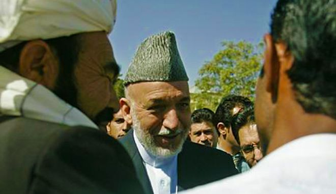 KABUL, AFGHANISTAN - OCTOBER 20:  Afghan President Hamid Karzai meets with elders after a conference on rural development, on October 20, 2010 in Kabul, Afghanistan. Karzai rejected pleas Wednesday from the international community to reverse his order to disband all private security companies, saying money spent on those firms should be invested in the national police force instead.  (Photo by Ahmad Massoud-Pool/Getty Images)