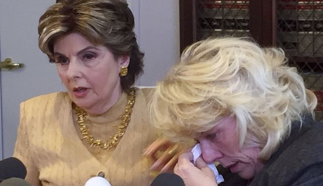 Heather Kerr, right, a former actress who alleges that entertainment mogul Harvey Weinstein sexually abused her in 1989, wipes her eye as her attorney Gloria Allred speaks at a news conference in Los Angeles Friday, Oct. 20, 2017. (AP Photo/Amanda Lee Myers)
