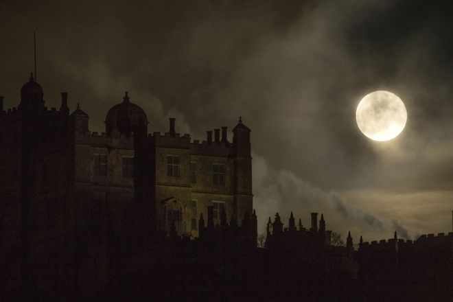 The moon rises over Bolsover Castle northwest England, Wednesday Jan. 31, 2018. On Wednesday, much of the world will get to see not only a blue moon which is a supermoon, but also a lunar eclipse, all rolled into one celestial phenomenon. Earth's natural satellite appears about 14% bigger and 30% brighter in the sky as it reaches its closest point to Earth. (Aaron Chown/PA via AP)