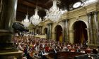 A general view during a plenary session at the Parliament of Catalonia in Barcelona, Spain, Wednesday, Sept. 6, 2017. Catalan lawmakers are voting on a bill that will allow regional authorities to officially call an Oct. 1 referendum on a split from Spain, making concrete a years-long defiance of central authorities, who see the vote as illegal. (AP Photo/Manu Fernandez)