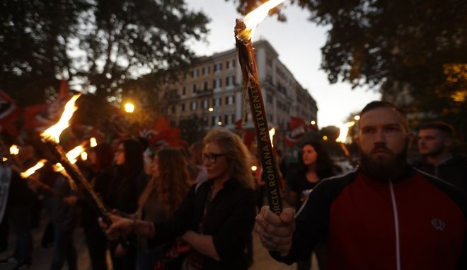 Members of the far-right group Casapound march during a rally to protest against an illegal mosque in Rome, Wednesday, Oct. 4, 2017.  (AP Photo/Gregorio Borgia)