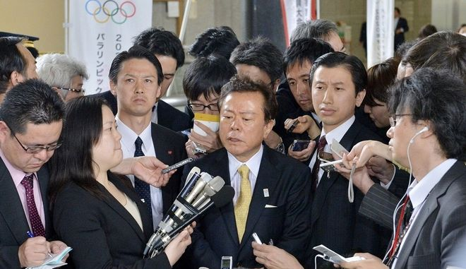 Tokyo Gov. Naoki Inose, center, speaks to the media at Tokyo Metropolitan Government Office in Tokyo Tuesday, April 30, 2013. Inose apologized on Tuesday for criticizing Istanbul, a rival candidate for the 2020 Olympics. Inose, also chairman of the bid committee, was quoted in the New York Times last weekend suggesting Istanbul was less developed and less equipped to host the games than the Japanese capital. (AP Photo/Kyodo News) JAPAN OUT, MANDATORY CREDIT