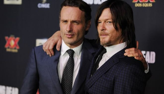 "Andrew Lincoln, left, and Norman Reedus, cast members in the television series ""The Walking Dead,"" pose together at a special screening for season five of the show on Thursday, Oct. 2, 2014, in Universal City, Calif. (Photo by Chris Pizzello/Invision/AP)"