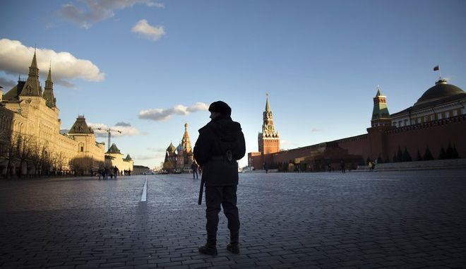 A police officer stands guard in Red Square in Moscow, Russia, Thursday, March 23, 2017. In the background, St. Basil Cathedral, center, Kremlin's Spassky Tower, right, and GUM department store, left. (AP Photo/Alexander Zemlianichenko)