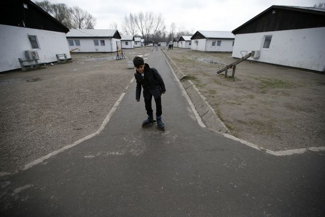 "Farhad Nouri roller-skates in the ""Krnjaca"" collective centre near Belgrade, Serbia, Monday, March 13, 2017. A 10-year-old boy from Afghanistan is known as Little Picasso among migrants in a Serbia asylum camp because of his artistic talent. Nouri, his parents and two younger brothers hope to move to Switzerland or the United States, but have been stuck in the Balkan country for months unable to cross the heavily guarded borders of the European Union. (AP Photo/Darko Vojinovic)"