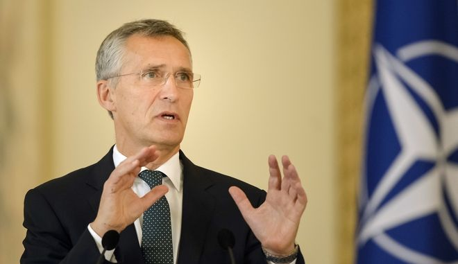 "NATO Secretary General Jens Stoltenberg gestures during a joint press conference with Romania's President, Klaus Iohannis at the Cotroceni presidential palace in Bucharest, Romania, Monday, Oct. 9, 2017. NATO's chief says the alliance does not want a ""new Cold War"" with Russia, despite members' concerns about Russian military buildup close to NATOs' border. (AP Photo/Andreea Alexandru)"