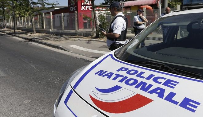 A police car parks near a bus stop in La Valentine district after a van rammed into two bus stops in the French port city of Marseille, southern France, Monday Aug.21, 2017. At least one person was killed. (AP Photo/Claude Paris)
