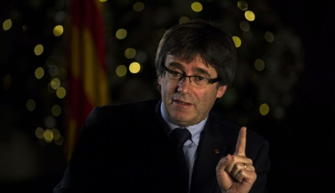 FILE - In this Dec. 16, 2016 file photo, Catalonia's regional president, Carles Puigdemont speaks during an interview with The Associated Press in Barcelona, Spain. Carles Puigdemont, the bespectacled politician heading the Catalan regional governments drive for secession from Spain, was an unknown entity for most Spaniards until a year ago.  (AP Photo/Emilio Morenatti, File)
