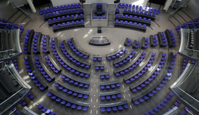 A general view of the German parliament Bundestag inside the plenary hall at the Reichstag building ahead of the German general election, in Berlin, Friday, Sept. 22, 2017. German voters will elect their new parliament on Sunday, Sept. 24, 2017, but dont expect a new government to be in place next week. With the seats expected to be spread across up to six caucuses, theres very little chance of anyone winning a majority to govern alone. (AP Photo/Markus Schreiber)