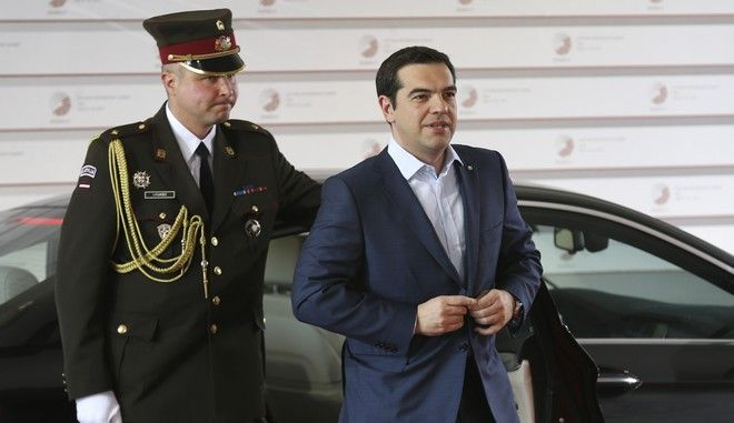 Greek Prime Minister Alexis Tsipras, right, arrives for a formal dinner at the Eastern Partnership summit in Riga, on Thursday, May 21, 2015. EU leaders on Thursday will seek new ways to bolster ties with six post-communist nations in Eastern Europe, a year and a half after a previous summit of the Eastern Partnership ended with a fateful standoff over Ukraine. (AP Photo/Mindaugas Kulbis)