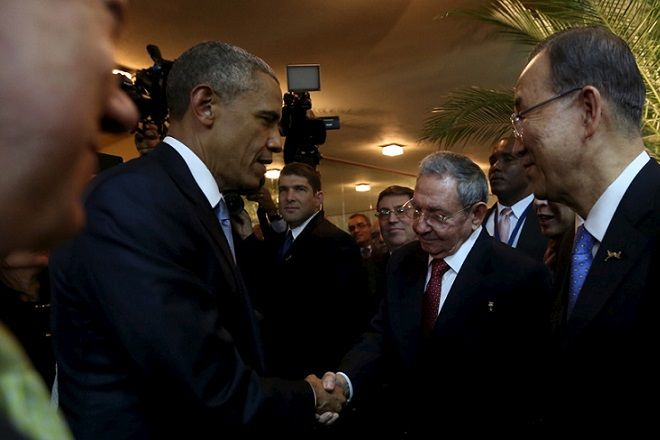 U.S. President Barack Obama (L) and his Cuban counterpart Raul Castro shake hands as U.N. Secretary General Ban Ki-moon (R) looks on, before the inauguration of the VII Summit of the Americas in Panama City April 10, 2015.  REUTERS/Panama Presidency/Handout via Reuters   ATTENTION EDITORS - THIS PICTURE WAS PROVIDED BY A THIRD PARTY. REUTERS IS UNABLE TO INDEPENDENTLY VERIFY THE AUTHENTICITY, CONTENT, LOCATION OR DATE OF THIS IMAGE. FOR EDITORIAL USE ONLY. NOT FOR SALE FOR MARKETING OR ADVERTISING CAMPAIGNS. THIS PICTURE IS DISTRIBUTED EXACTLY AS RECEIVED BY REUTERS, AS A SERVICE TO CLIENTS       TPX IMAGES OF THE DAY      - RTR4WVQ8