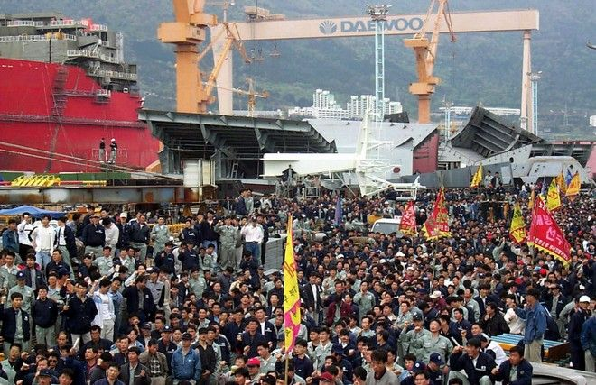 Striking shipyard workers gather for a rally at the Daewoo shipyard in Koje, South Korea, Wednesday, April 21, 1999. More than 4,000 workers are striking to protest plans to sell off Daewoo's shipbuilding division. Daewoo, the nation's second biggest conglomerate, announced a restructuring plan Monday which involves selling off some of its most lucrative business units. (AP Photo/Yonhap)