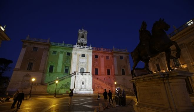 The facade of Rome's Campidoglio Capitol Hill is lit with the colors of the Italian flag, in Rome, Saturday, July 2, 2016. Italy's foreign minister said the bodies of nine Italians have been identified after a group of armed extremists stormed a restaurant in Bangladesh. (AP Photo/Andrew Medichini)