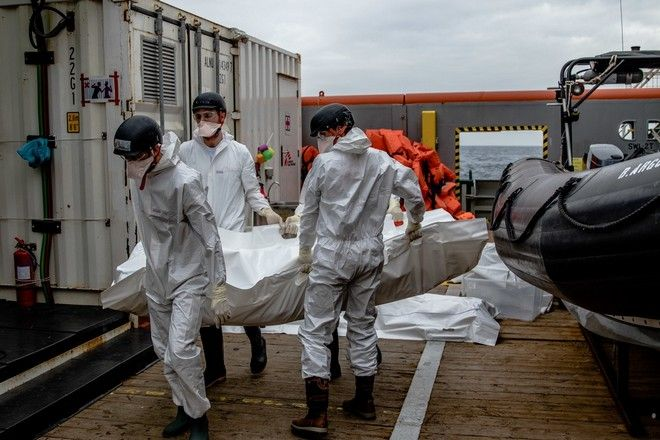 The MSF team carries a corpse to the morgue aboard the Bourbon Argos.   At 9am, 17 November 2016 MSF received a transfer of 27 people (all men) and 6 dead bodies who had been rescued by the British Naval ship, HMS Enterprise.