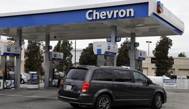 In this Tuesday, April 25, 2017, photo, a motorist drives near the pumps at a Chevron gas station, in Oakland, Calif. Chevron Corp. reports earnings on Friday, April 28, 2017. (AP Photo/Ben Margot)