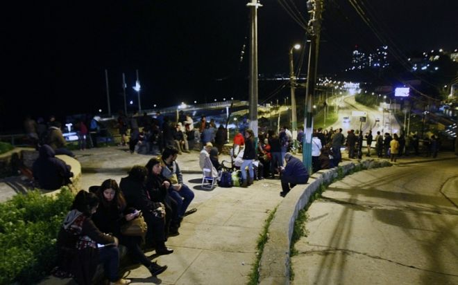 People remain in the street after a tsunami alert in Valparaiso, Chile on September 16, 2015. A strong 7.9-magnitude earthquake struck the center of Chile on Wednesday, US seismologists said, triggering a tsunami alert that stretched to Peru and the evacuation of coastal areas. AFP PHOTO /ESTEBAN ZUNIGAESTEBAN ZUNIGA/AFP/Getty Images