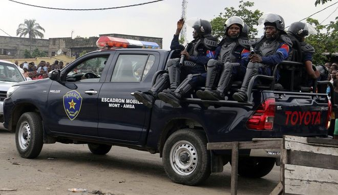 Congolese police patrol outside the main prison in Kinshasa, Congo, Wednesday May 17, 2017. Christian sect members stormed a prison in Congo's capital Wednesday, freeing the leader of their movement and 50 others, Congo's justice minister said. Bundu dia Kongo movement leader Ne Mwanda Nsemi is now on the run after a 4 a.m. attack on Malaka prison in Kinshasa, Justice Minister Alexis Thambwe Mwamba told local radio station Top Congo FM. (AP Photo/John Bompengo)