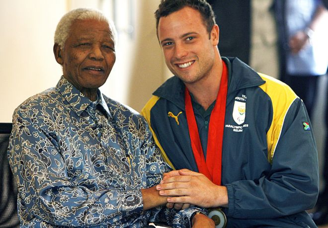 Former South African President, Nelson Mandela and Oscar Pistorius Former South African President, Nelson Mandela with Oscar Pistorius, South Africa - 03 Oct 2008 Former South African President, Nelson Mandela congratulates Oscar Pistorius after winning three gold medals at the Beijing Paralympics  (Rex Features via AP Images)