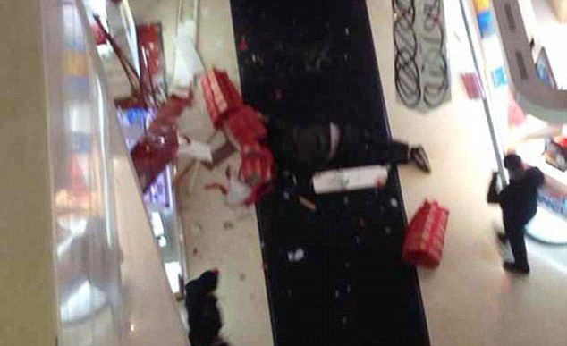 Enraged Chinese boyfriend Tao Hsiao, 38, jumped to his death after a furious row with his girlfriend, 23, after she insisted on going into yet another clothes shop.  According to CCTV images the pair had already been at the shopping mall in the city of Xuzhou in Jiangsu province in the east of China for five hours when Tao had said he had finally had enough, and demanded to go home.  He complained that they already had more bags than he and his girlfriend could carry, but she insisted on going into one more shop where the was a special offer on shoes.  An eyewitness said: