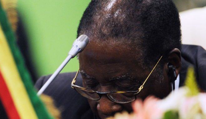 Zimbabwe's President Robert Mugabe appears to be asleep, during the first plenary session of the 3rd Africa-EU Summit in Tripoli, Libya, Monday Nov. 29, 2010. 80 African and European Heads of State and Government and some 50 observers from third countries met in Tripoli to discuss concrete ways to stimulate inclusive growth, to create employment opportunities, and to use sustainable development as a driver for growth. (AP Photo/Geert Vanden Wijngaert)