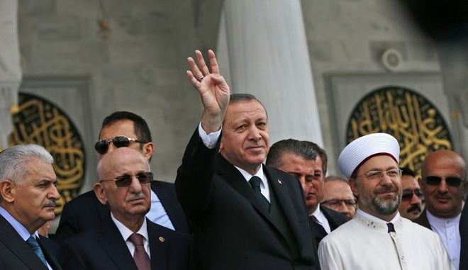 Turkey's President Recep Tayyip Erdogan, centre, waves to supporters, during the inauguration ceremony for the Melike Hatun mosque in Ankara, Turkey, Friday, Oct 27, 2017. (AP Photo/Burhan Ozbilici)