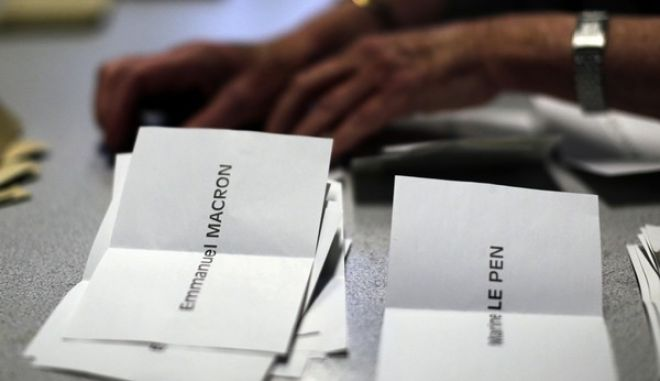 Ballots are counted by volunteers for the first-round presidential election at a polling station in Paris, Sunday, April 23, 2017. French voters have casted ballots for the presidential election in a tense first-round poll that's seen as a test for the spread of populism around the world. (AP Photo/Emilio Morenatti)