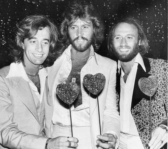 The Bee Gees, from left, Robin, Barry and Maurice Gibb, attend a party following the Hollywood premiere of
