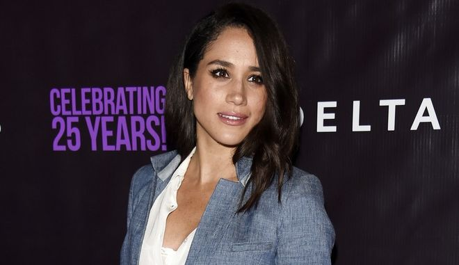 "FILE - In this May 20, 2016. file photo, actress Meghan Markle poses at P.S. Arts' ""the pARTy!"" in Los Angeles. Markle told Vanity Fair for an interview published online on Sept. 5, 2017, that she and Prince Harry are two people who are really happy and in love. (Photo by Chris Pizzello/Invision/AP, File)"