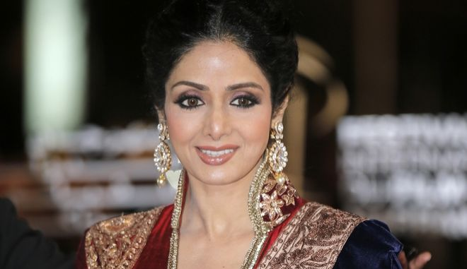 FILE - In this Dec. 1, 2012 file photo, Indian actress Sridevi arrives at the Marrakech International Film Festival in Marrakech, at the Marrakech Congress Palace. Sridevi, Bollywoods leading lady of the 1980s and 90s who redefined stardom for actresses in India, has died at age 54. The actress, known by one name, was described as the first female superstar in Indias male-dominated film industry. Her brother-in-law Sanjay Kapoor speaking to the Indian Express online confirmed she died Saturday, Feb. 24, 2018,  in Dubai due to cardiac arrest.(AP Photo/Lionel Cironneau, File)