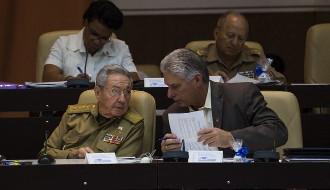 Cuba President Raul Castro, front left, speaks with his first vice-president Miguel Diaz-Canel during a session of the National Assembly in Havana, Cuba, Thursday, Dec. 21 2017. Cubas National Assembly has extended its term by two months, until April 2018, a signal that Castro will remain in the presidency longer than expected. (Irene Perez/Cubadebate via AP)