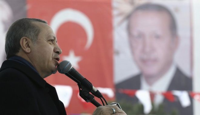 """Turkey's President Recep Tayyip Erdogan addresses his supporters in Istanbul, Saturday, March 11, 2017. Turkey and the Netherlands sharply escalated a dispute between the two NATO allies on Saturday as the Dutch withdrew landing permission for the Turkish foreign minister's aircraft, drawing Turkish President Recep Tayyip Erdogan to call them """"fascists."""" (Kayhan Ozer/Presidential Press Service, Pool Photo via AP)"""