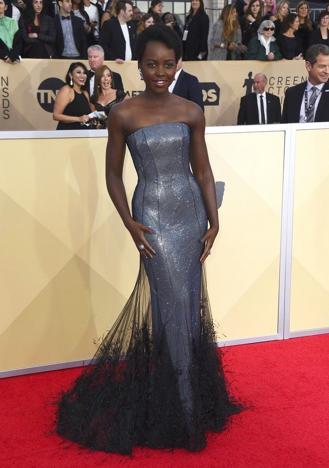 Lupita Nyong'o arrives at the 24th annual Screen Actors Guild Awards at the Shrine Auditorium & Expo Hall on Sunday, Jan. 21, 2018, in Los Angeles. (Photo by Jordan Strauss/Invision/AP)
