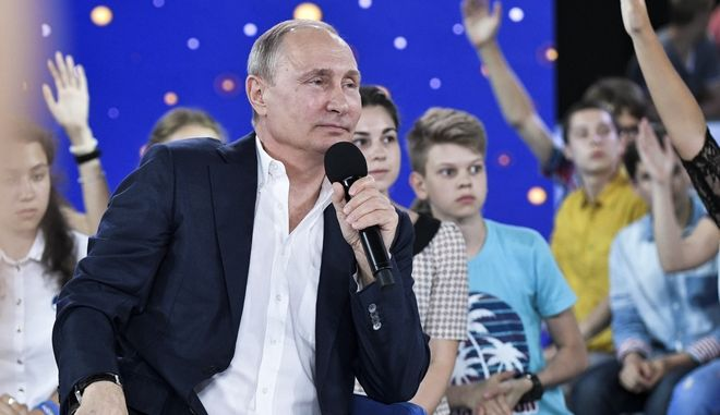 Russian President Vladimir Putin speaks to the students while visiting the Sirius Educational Centre for Gifted Children in the Black Sea resort of Sochi, Russia, Friday, July 21, 2017. (Alexei Nikolsky/Sputnik, Kremlin Pool Photo via AP)
