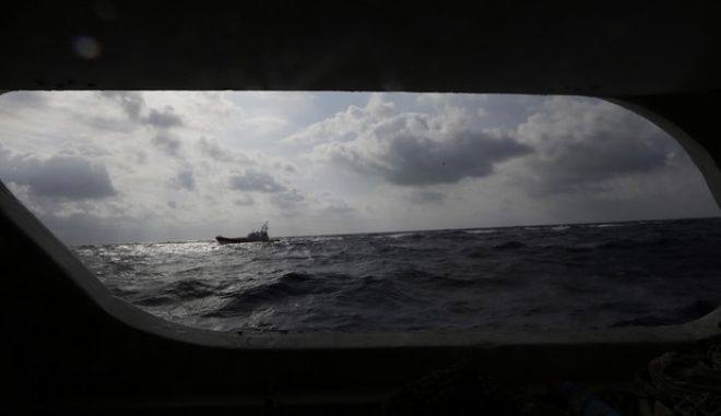 A Coast Guard boat maneuvers above the exact point where the wreck of a ship carrying African migrants towards Italy rests on the seabed after it capsized Thursday off the Sicilian island of Lampedusa, Italy, Saturday, Oct. 5, 2013. Authorities say the search to recover bodies from the sunken boat has been called off for a second day because of bad weather. The ship capsized after the migrants on board started a fire to attract attention. Just 155 people survived, 111 bodies have been recovered and more than 200 are still missing. (AP Photo/Luca Bruno)