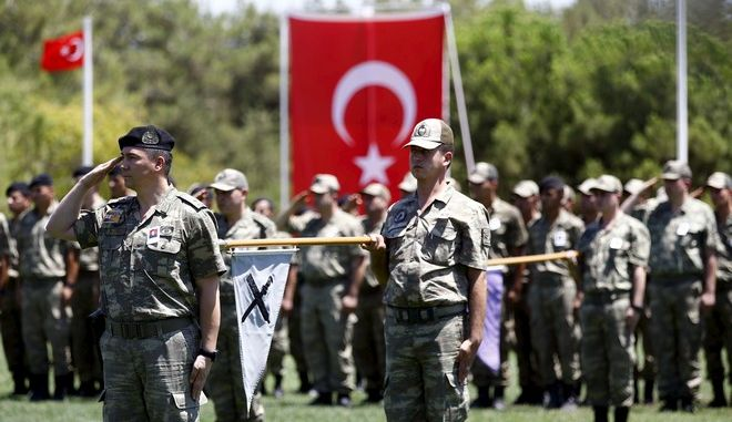 Turkish soldiers stand at attention during a ceremony for their comrade Mehmet Yalcin Nane who was killed by Islamic State militants on Thursday, at a military base in Gaziantep, Turkey, July 24, 2015. Turkish warplanes pounded Islamic State targets in Syria and police detained hundreds of suspected militants across Turkey on Friday, a sign that Ankara may have shed its hesitancy in taking a front-line role against jihadist fighters. Turkey has long been a reluctant partner in the U.S.-led coalition against Islamic State, emphasising the need to oust Syrian President Bashar al-Assad and saying Syrian Kurdish forces also pose a grave security threat. REUTERS/Murad Sezer - RTX1LNSV