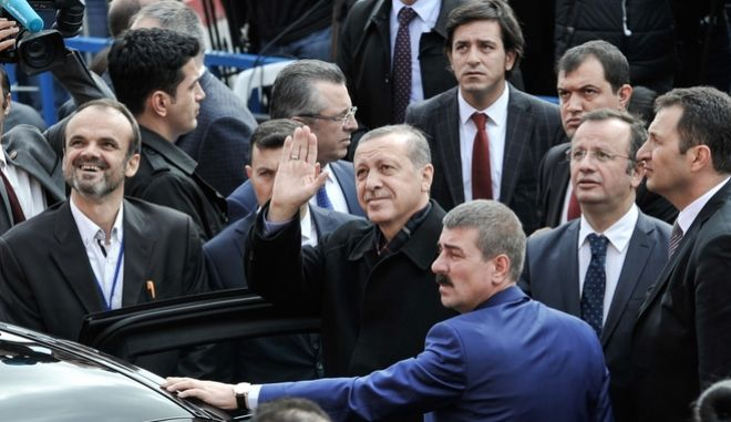 Supporters of the AKP Party surround and cheer the Turkish President Tayyip Erdogan as he exits the polling station after casting his vote for the country`s 26th General  Election, in Istanbul, Turkey, on November 1, 2015