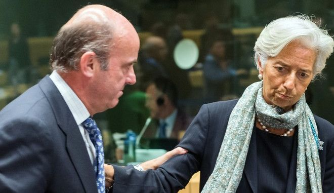 Managing Director of the International Monetary Fund Christine Lagarde, right, speaks with Spanish Economy Minister Luis de Guindos during a meeting of eurogroup finance ministers at the European Council LEX building in Brussels on Monday, June 22, 2015. Heads of state in the eurogroup meet in Brussels on Monday for a special summit to discuss the financial crisis with Greece. (AP Photo/Geert Vanden Wijngaert)