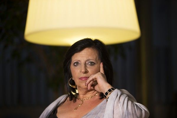 In this photo taken on Wednesday, July 19, 2017, Pilar Abel, poses for a photograph after a news conference in Madrid, where she claimed to be the daughter of eccentric artist Salvador Dali.  61-year old tarot card reader, Abel claims that her mother had an affair with Salvador Dali while working as a domestic helper in the northeastern Spanish town of Figueres, where the artist was born and lived with his Russian wife Gala.  After two decades of court battles, a Madrid judge granted Abel a DNA test to find out whether her allegations are true, and the exhumation is scheduled to begin Thursday night. (AP Photo/Francisco Seco)