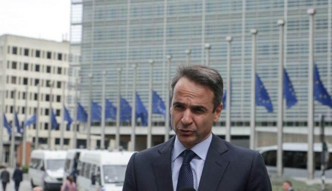 Greece's main opposition party leader Kyriakos Mitsotakis arrives to the summit of the European People's Party in Brussels, Belgium, on October 19, 2017. /               , , , 19  2017.