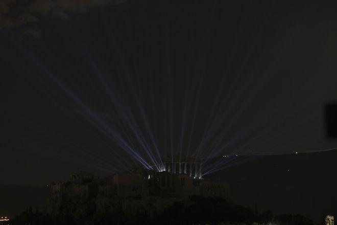 A new lighting system illuminates the Parthenon temple atop of the ancient Acropolis hill in Athens, Wednesday, Sept. 30, 2020. Ancient temples on the Acropolis are illuminated after a new lighting system was installed and launched. The lower-energy LED lighting fixtures will light up more parts of the ancient site and is also intended to reduce light pollution with better-targeted lighting. (AP Photo/Yorgos Karahalis)